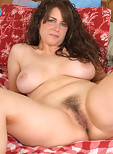 Cute as a button MILF with nice tits and a furry pussy