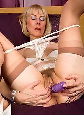 hairy mature, 63 year old Hazel pulls her panties aside to display a full bush