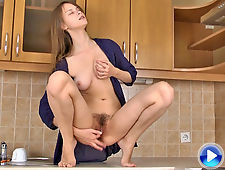 Hairy girl Beata cooks supper and heats up pussy