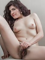 In white, Rimma S strips and enjoys herself