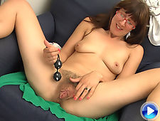 Valentine fucks her hairy pussy with kegal beads