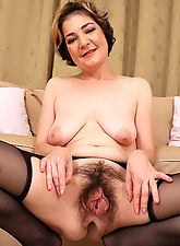 hairy mature women, 42 year old Eszti in stockings spreading her hairy pussy wide for you