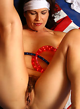 Mature brunette Andie shows of furry pussy the patriotic way