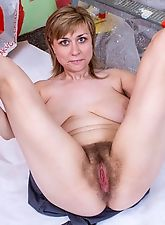 Hairy girl Nira gets hard at work