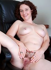Artemesia shows her hairy pussy at work